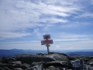 Mt. Moosilauke sign covered in snow