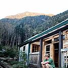 Alpenglow over Carter Notch Hut by Kerosene in Carter Notch Hut
