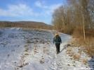Deb walks along field