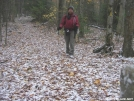 CH hiking on snowy leaves