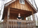 Princess Leah stands on cabin porch at Hot Springs Campground by cabeza de vaca in Section Hikers