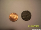 Burnt penny next to unburnt penny